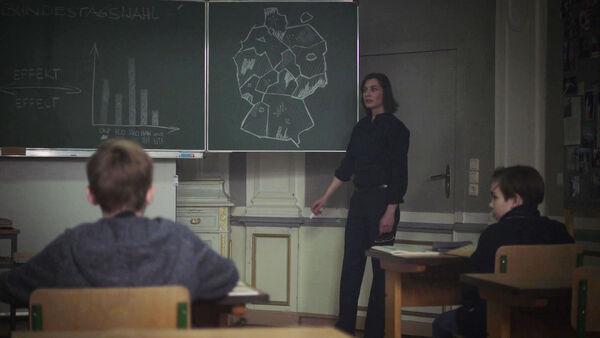 Christiane-Paul-Mira-Teaches-Politics-Counterpart-STARZ-Season-1-Episode-8-Love-the-Lie