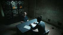 JK-Simmons-Karan-Oberoi-D1-Howard-Osman-questioning-Counterpart-STARZ-Season-2-Episode-02-Outside-In