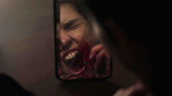 Sara-Serraiocco-treating-Balwin's-gunshot-wound-Counterpart-Starz-Season-1-Episode-2-Birds-of-a-Feather