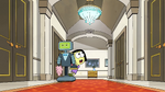 Tilly rides the robot butler down the hall