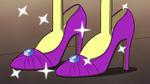 Tilly tries on purple heels