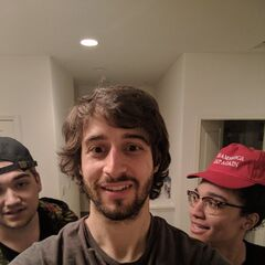 Jakob wearing a MAGA hat