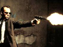 Agent-smith-firing-gun-the-matrix