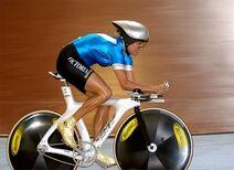 Female cyclist in blue