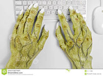 Monster-keyboard-hands-pair-halloween-using-mouse-against-white-background-34444536
