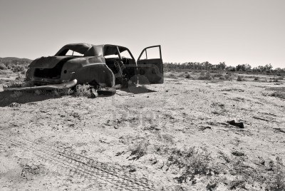 3228803-black-and-white-image-of-an-old-rusty-car-in-the-desert