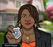 Gloria Mostrando su placa