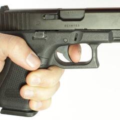 A Glock 19 being held.