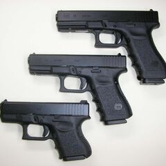 A Glock 26 (bottom) with a <a href=