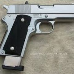An M1911 pistol with an extended magazine.