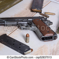 An M1911 with magazines around it.