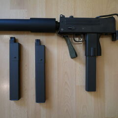 A MAC-10 with a suppressor attached.