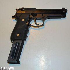 A Beretta 92FS holding a high-capacity magazine.
