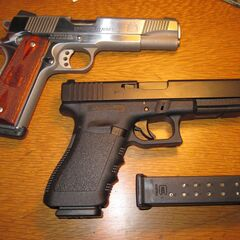 An M1911 with a Glock 21