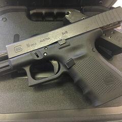 A Glock 19 in a case.