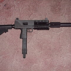 A MAC-10 outfitted with a suppressor and an extended stock.