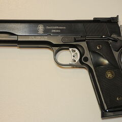 An M1911 pistol designed by Smith & Wesson.