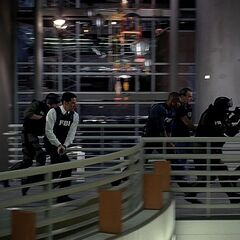 SWAT officers swarming a bulding with M4A1s in