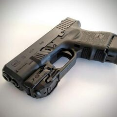 Glock 26 with light attachment.