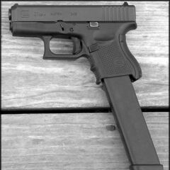 A Glock 26 with an extended magazine