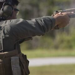 A Soldier firing two M1911s.