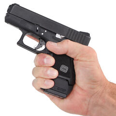 A Glock 26 being held