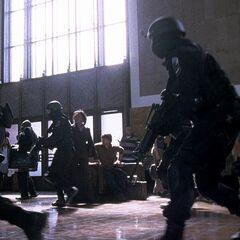 SWAT officers sweep the building with M4A1s in