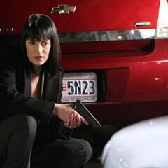 A promotional image of Prentiss with her Glock 19.