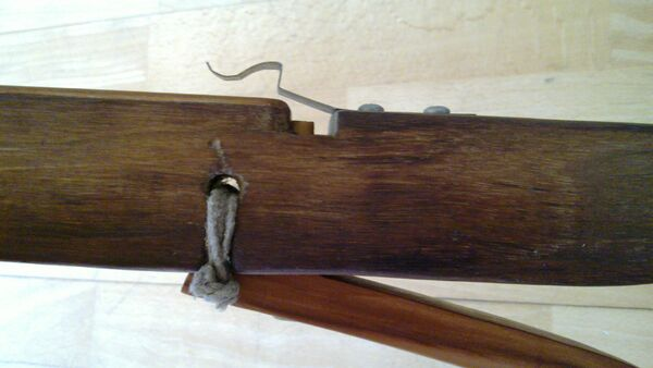Pin lock - ready for bowstring - side