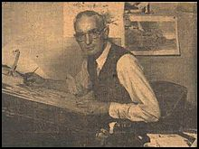 A photograph of Jimmie Frise at his drawing board