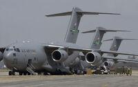 Air force globemasters unload supplies