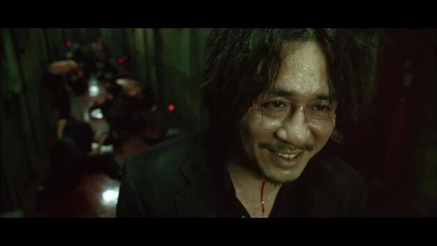 Oh Dae-su, laughing at his captors