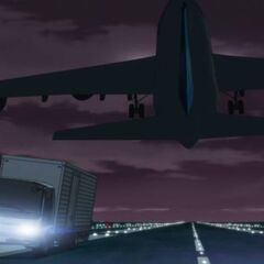 Genma has to avoid a plane while chasing Hei.