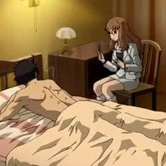 Yōko aids Genma with his obeisance.