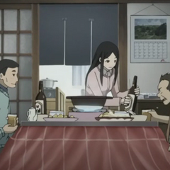 Isozaki dines with his wife and Huang.