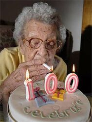 Lighting-a-cigarette-off-a-100-candle-funny-old-la
