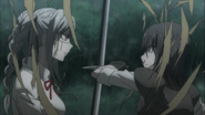 Despair Arc Episode 8 - Peko dodges Mukuro's swipes with her sword