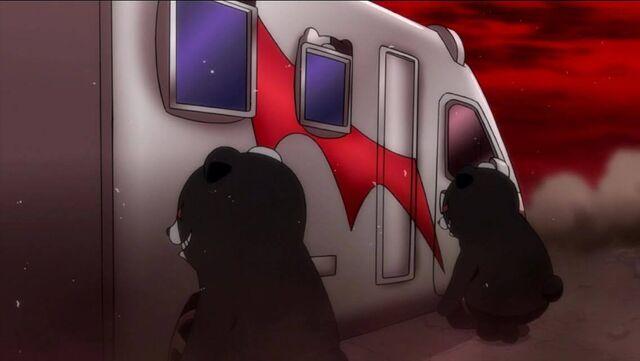 File:Monokuma carring a car.jpg