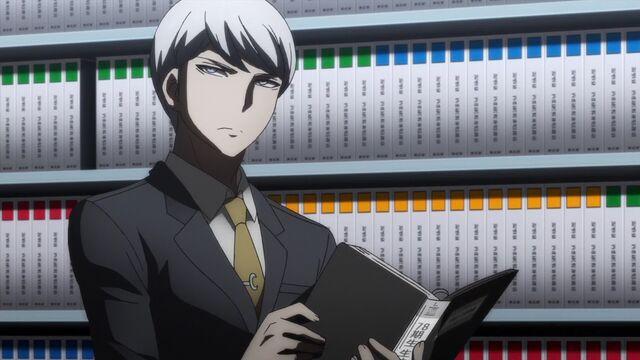 File:Munakata reading files.JPG