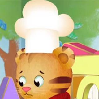 Daniel wearing a chef's hat in