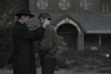 DARK Still 110 - Noah and Helge outside church