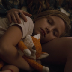 Elisabeth sleeps hugging a fox