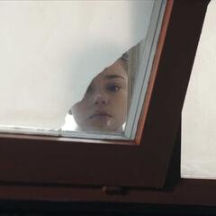Hannah peers through the window