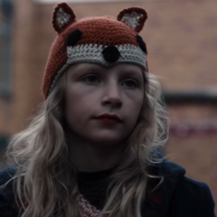 Elisabeth wears a fox beanie