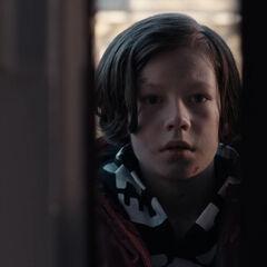 Mikkel peers through the door