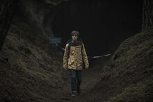 DARK Still 106 - Jonas outside caves