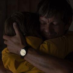 Son-father hug