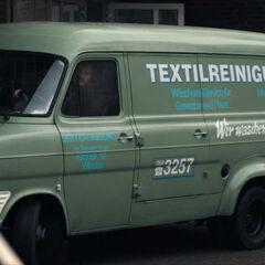 Sebastian driving the dry cleaning van
