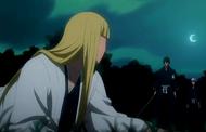 Aizen looks down upon a fallen Shinji