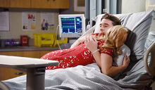 Chad-hugging-abby-hospital-bed-days-XJj
